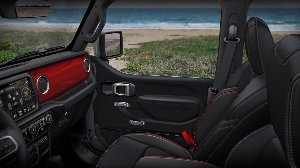 The Jeep Wrangler interior, featuring passenger side door