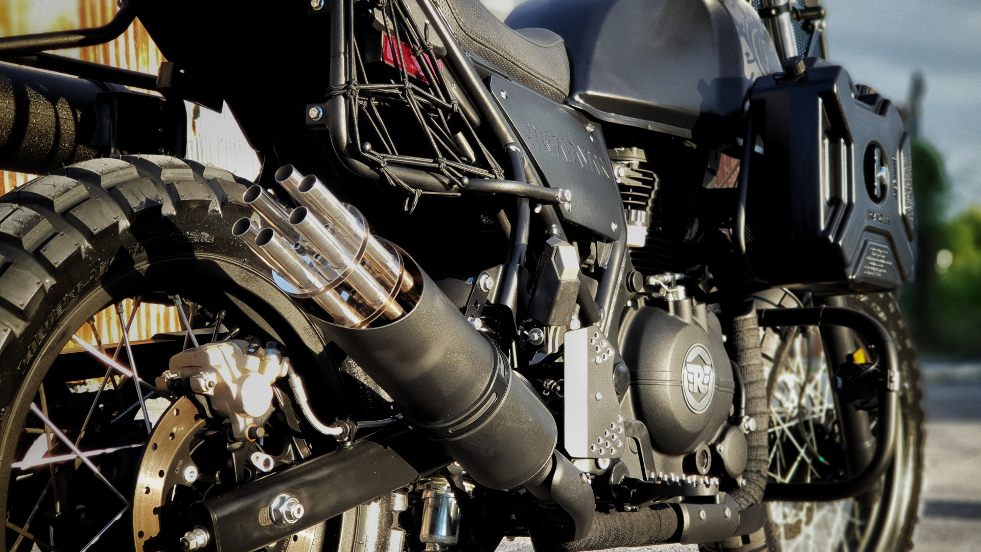 Iron Macchina Customs' Royal Enfield Himalayan engine and exhaust from the rear
