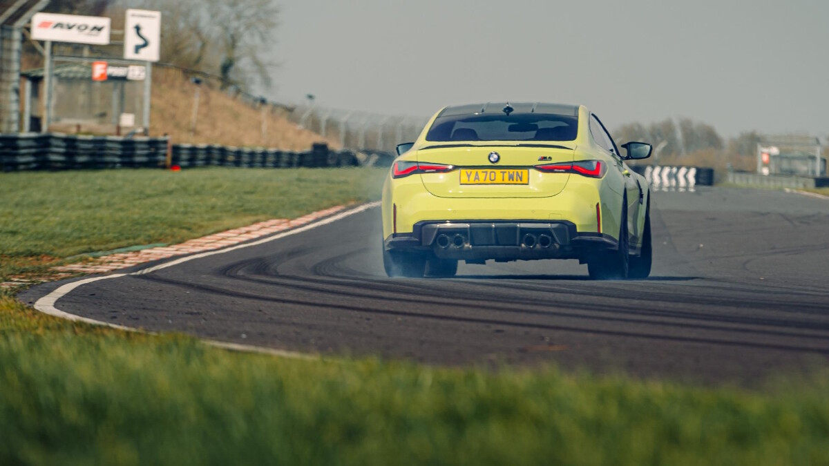 The BMW M4 Competition rear view on the road