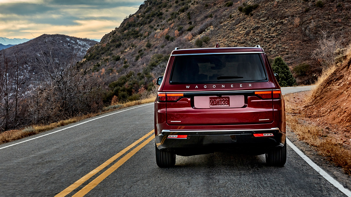 The Jeep Wagoneer rear view on the road