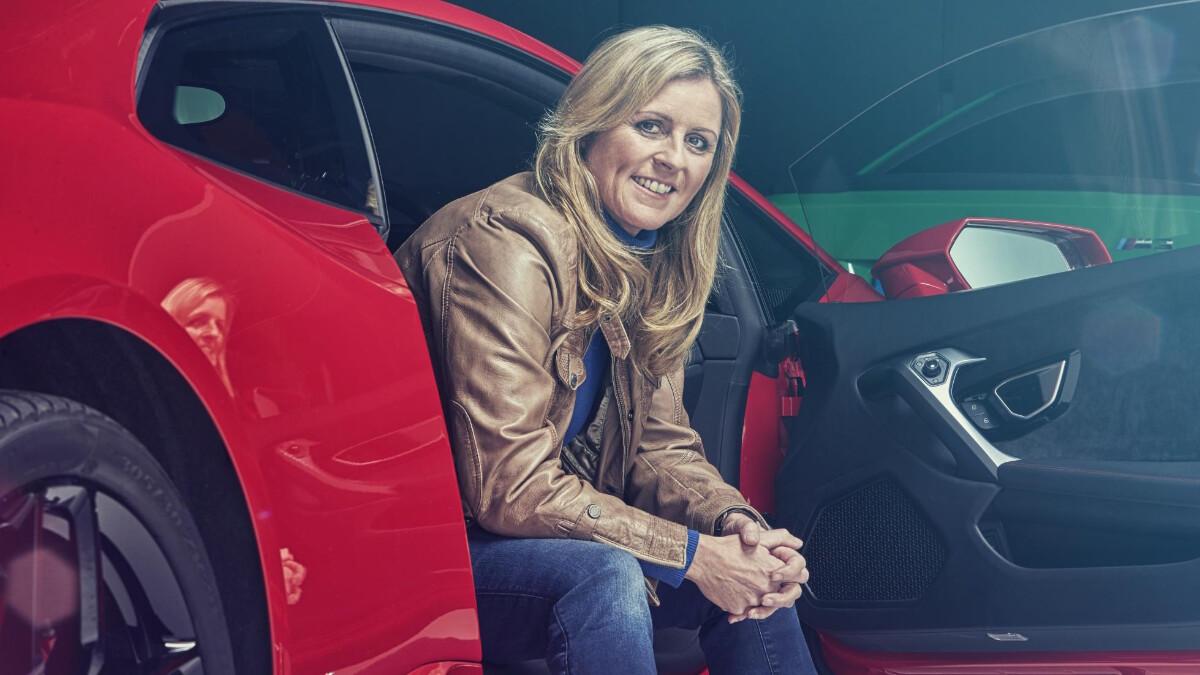Sabine Schmitz posing with a car