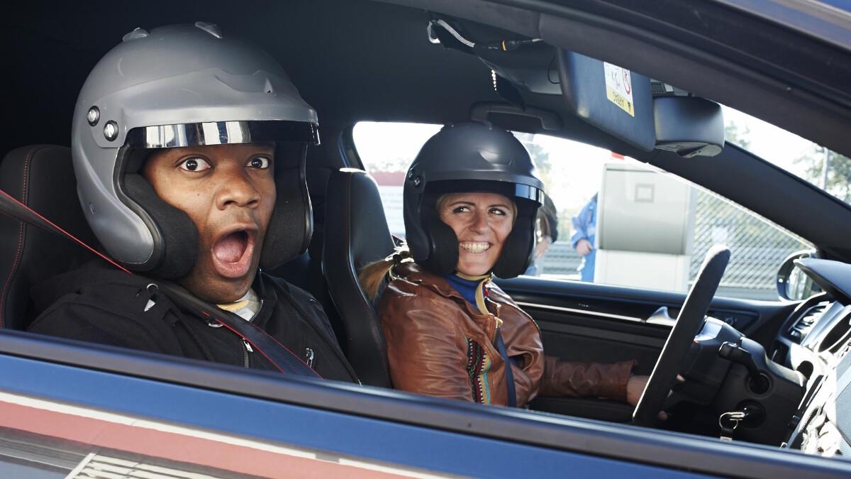 Sabine Schmitz with Chris Harris inside a car