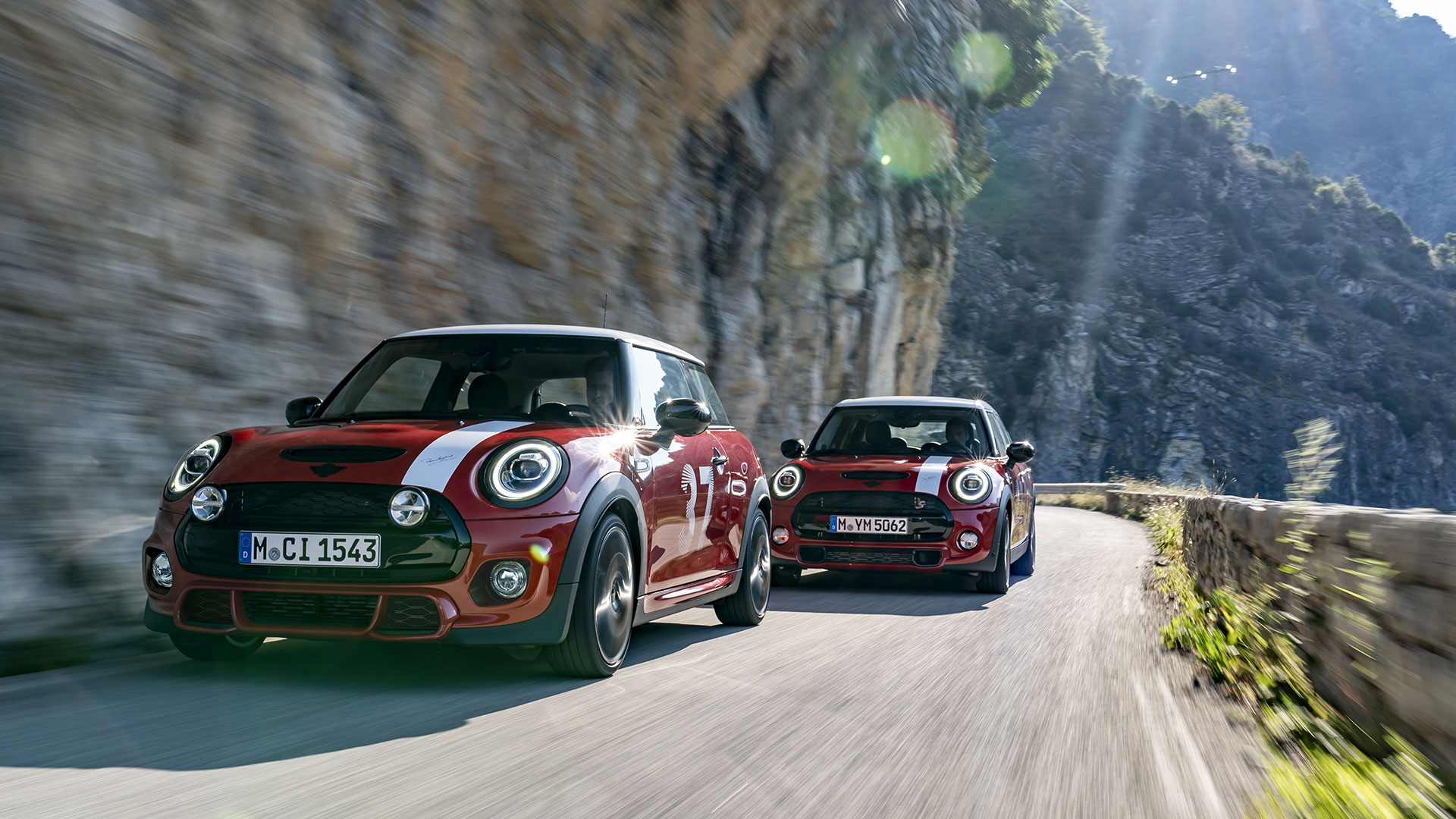 two Mini Paddy Hopkirk Edition cars on the road