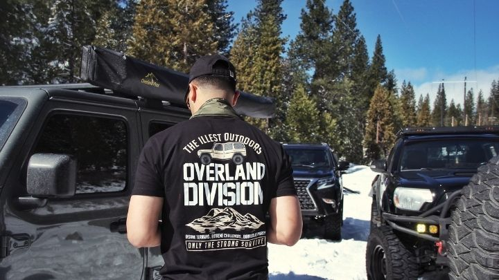 Man wearing a black shirt - From the Illest Overland Adventure