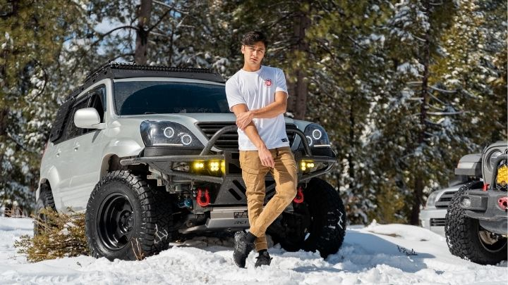 Man wearing cargo pants and white shirt - From the Illest Overland Adventure