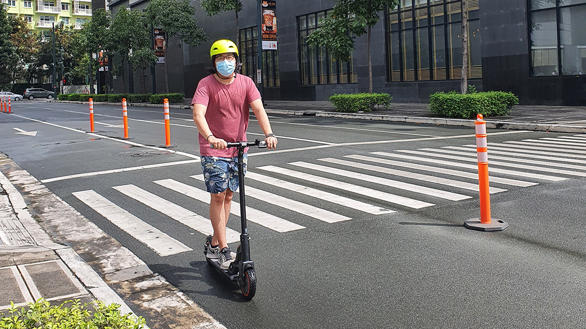 The Lenovo M2 Electric Kick Scooter as used by an adult