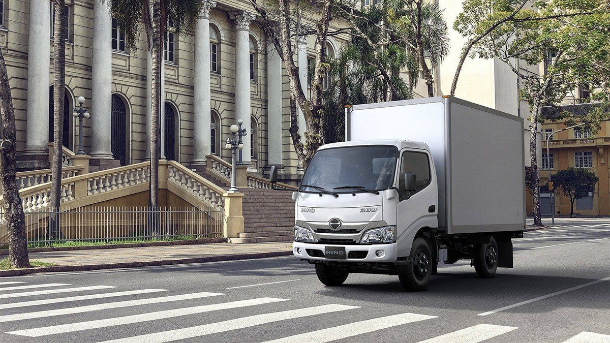 The New Hino Truck On a Street Crossing