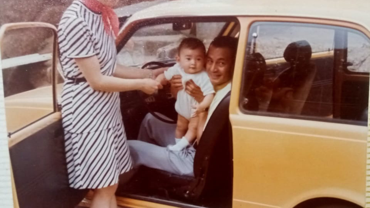 A Vintage Photo of an old Mitsubishi Car with the Reyes Family