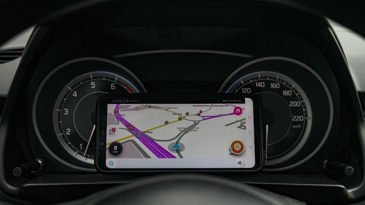 The Suzuki Dzire Odometer with Phone