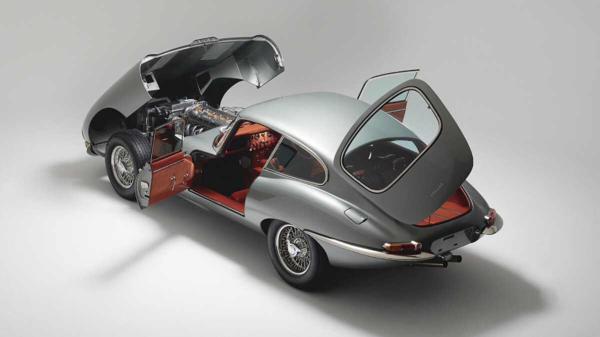 Helm's Jaguar E-Type Restomod Opened Hood, Doors, and Trunk.