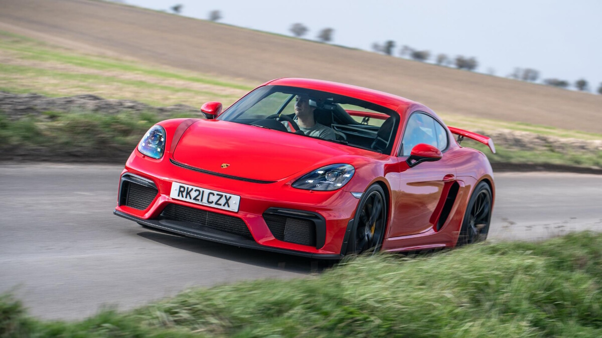 The Porsche 718 Cayman GT4 Angled Front View on the Road