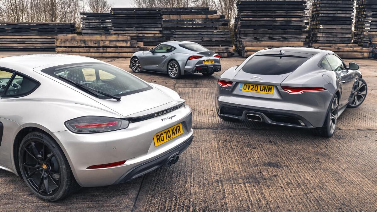 The Porsche, Jaguar, and Toyota parked