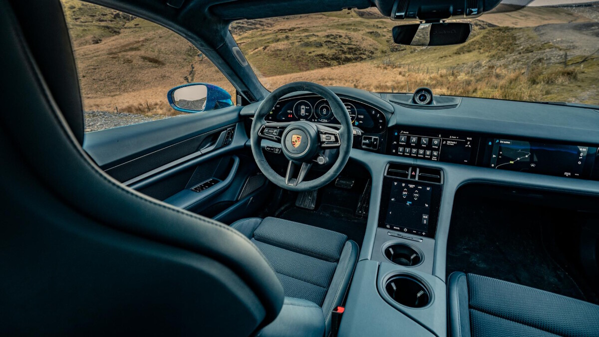 The 2022 Porsche Taycan Cross Turismo Crossing a Bridge
