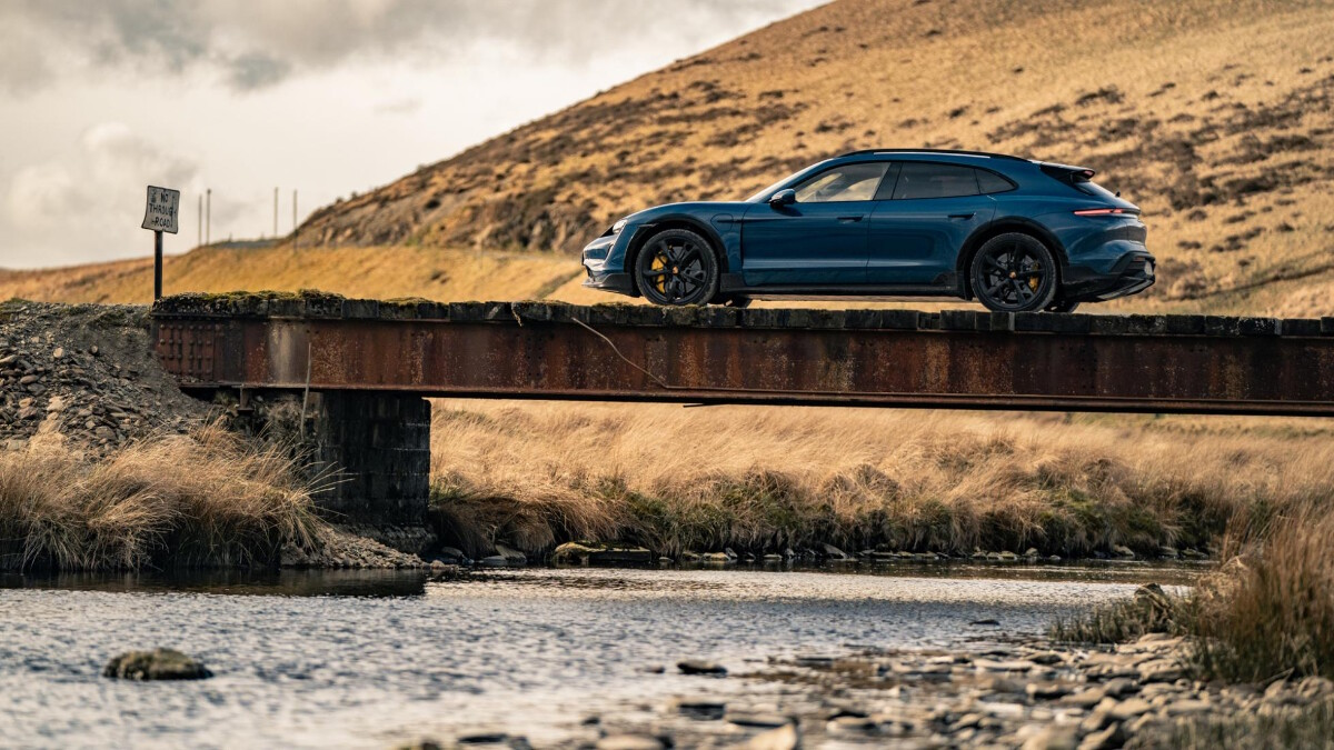 The 2022 Porsche Taycan Cross Turismo Angled Front View, on the road