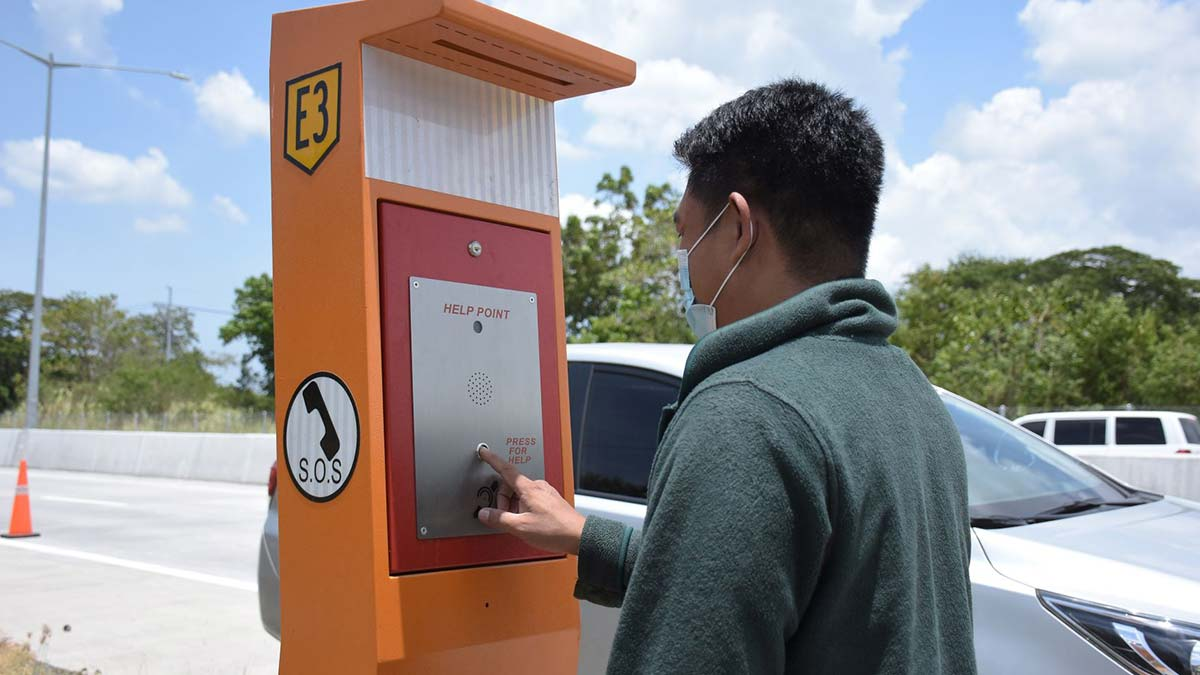 An Emergency Roadside Communication System being used by a man.