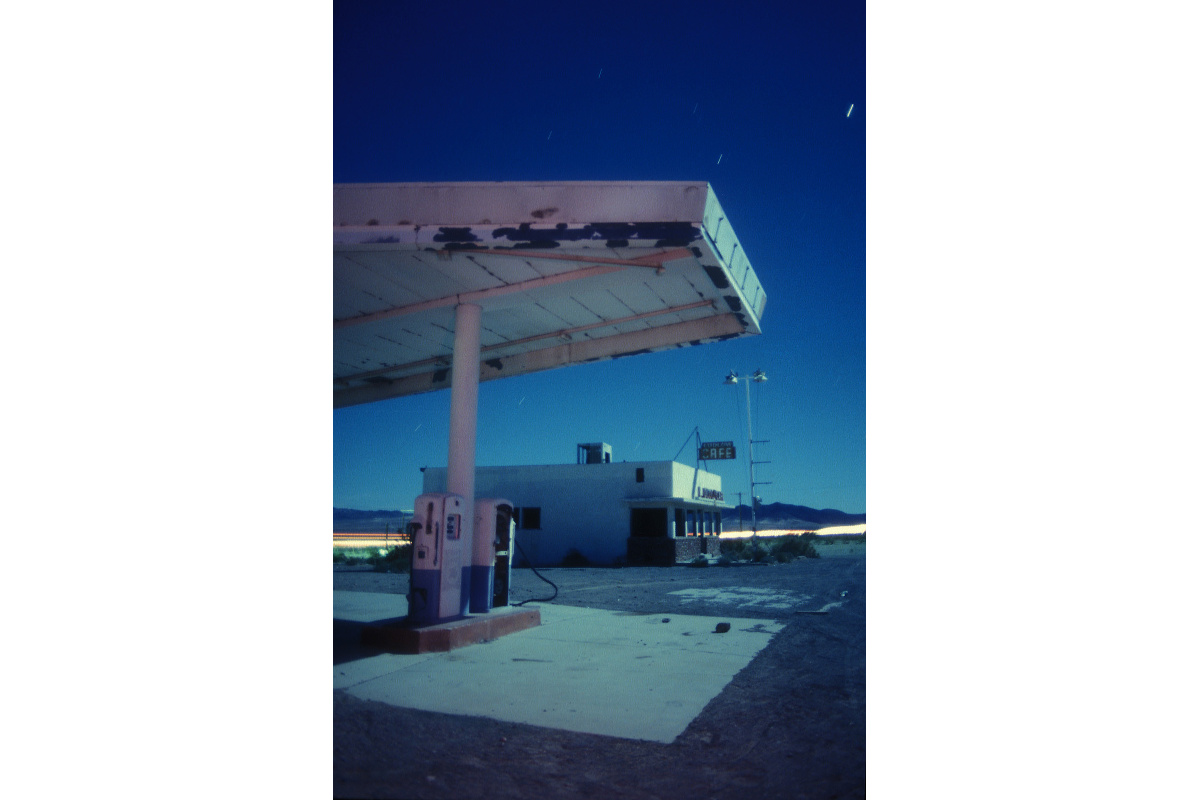 'Pre-Kalifornia' – April 1989 and already shooting abandoned Route 66 structures; this was at Ludlow, California. Eight minutes of full moon on Kodak 160T film, lit with a AA Maglite.