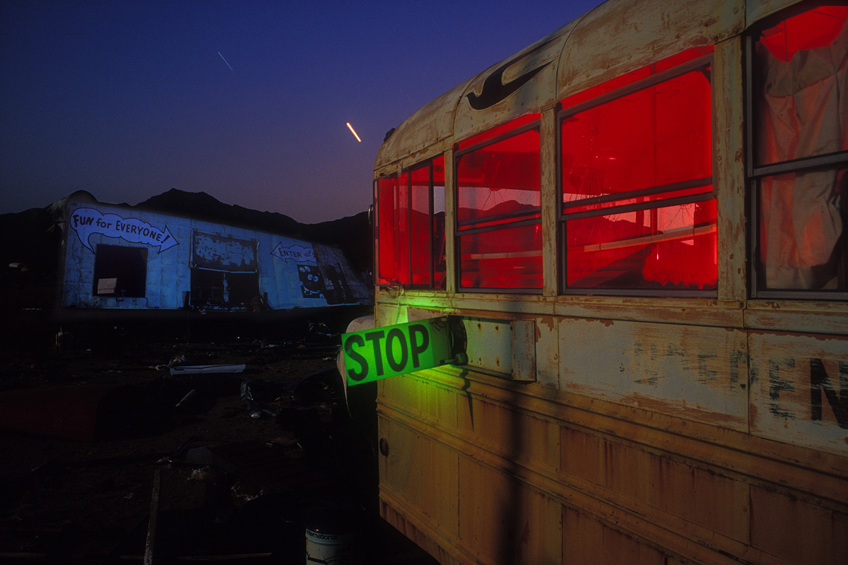 'Fun for Everyone' – Derelict school bus and amusement-park ride, left behind at an abandoned trailer park at Essex, California. On Kodak 100VS film in 2002.