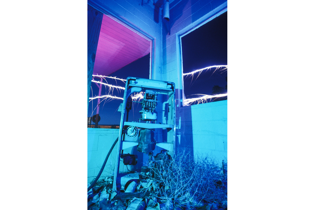 'Skeletal Pump' – I had to kneel in deep broken glass to get the shot in this San Fidel New Mexico Whiting Brothers Station. September 2000, on Kodak 160T film, with gelled strobe and sparklers.