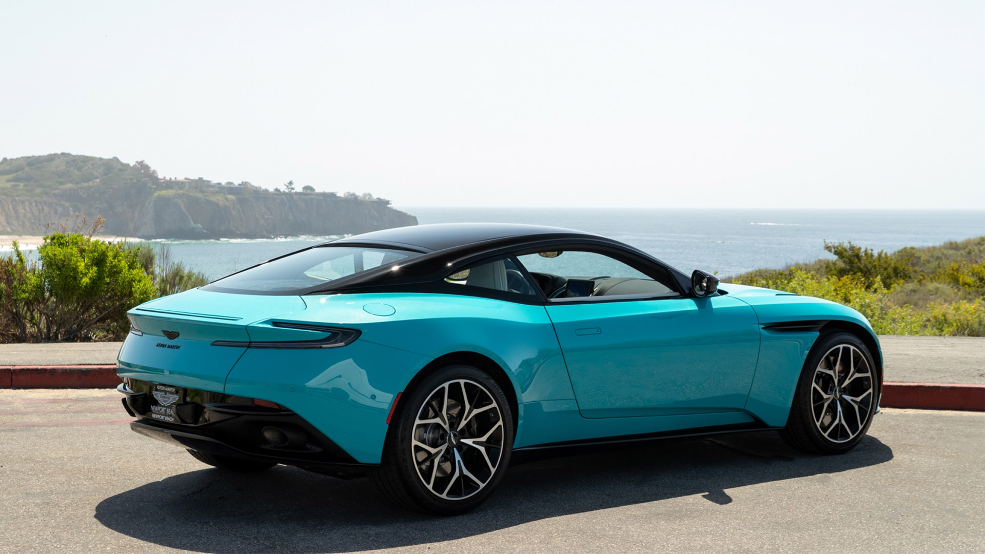 The Aston Martin DB11 Coupe in Butterfly Teal Angled Rear View