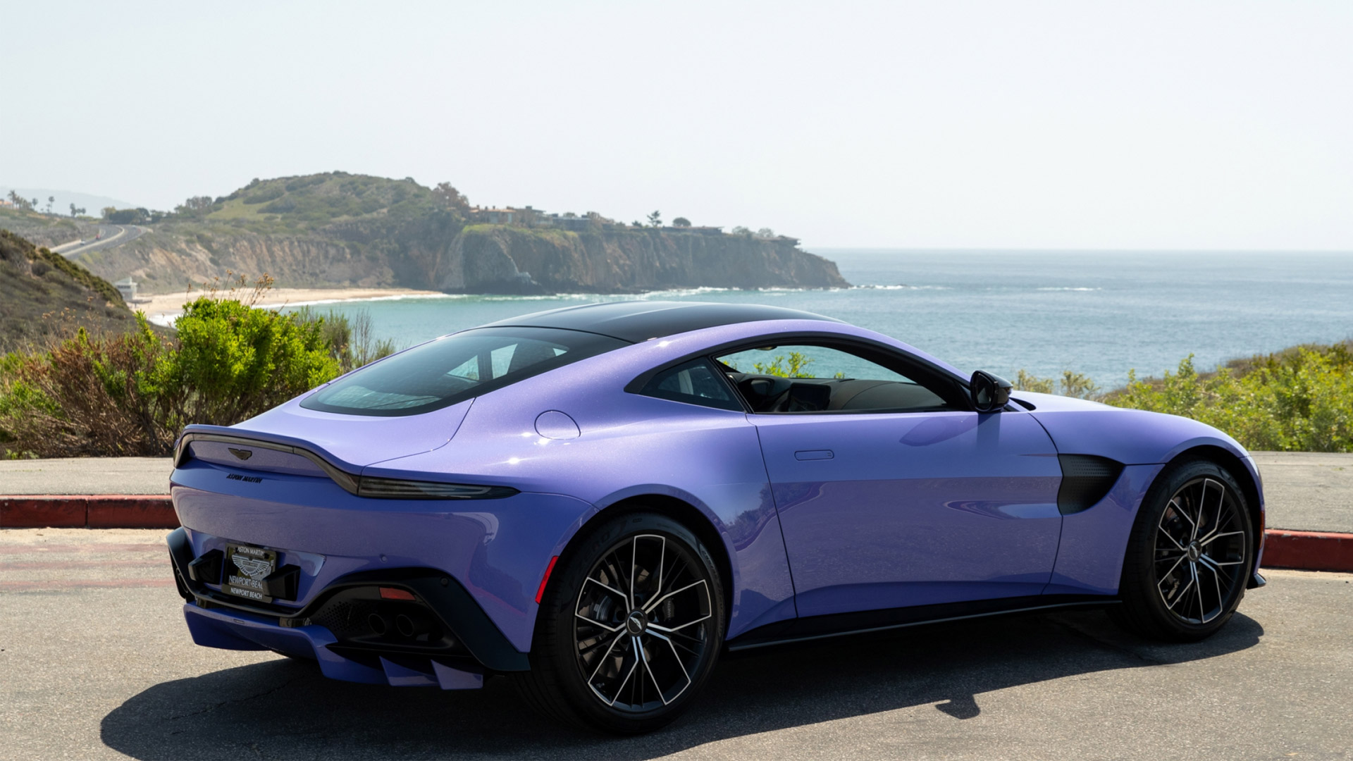 The Aston Martin Vantage Coupe in Ultra Violet Angled Rear View