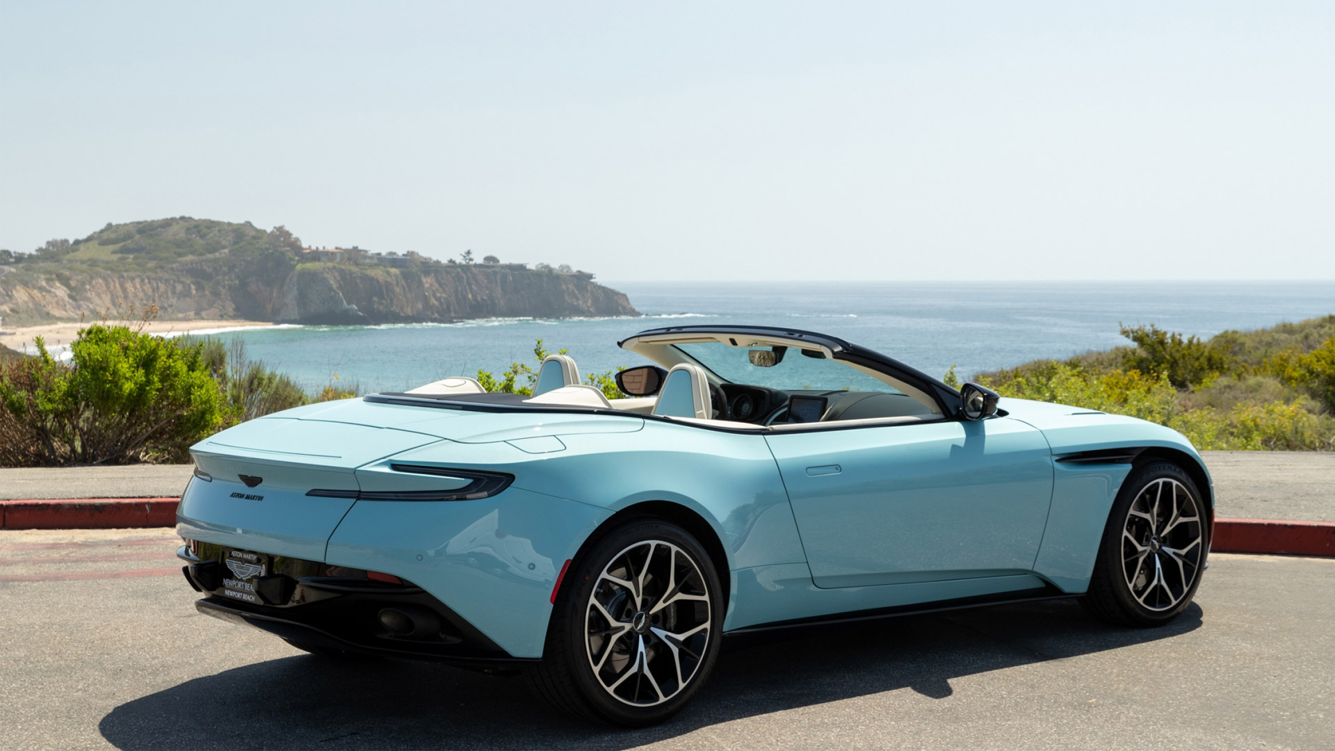 The Aston Martin DB11 Volante in Light Blue with the Top Down