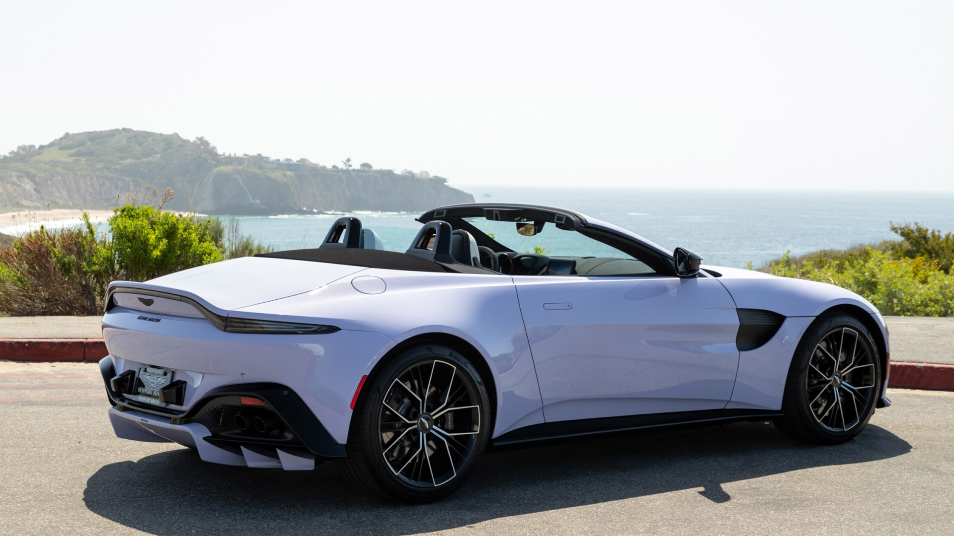 The Aston Martin Vantage Roadster in Cardamom Violet Angled Rear View