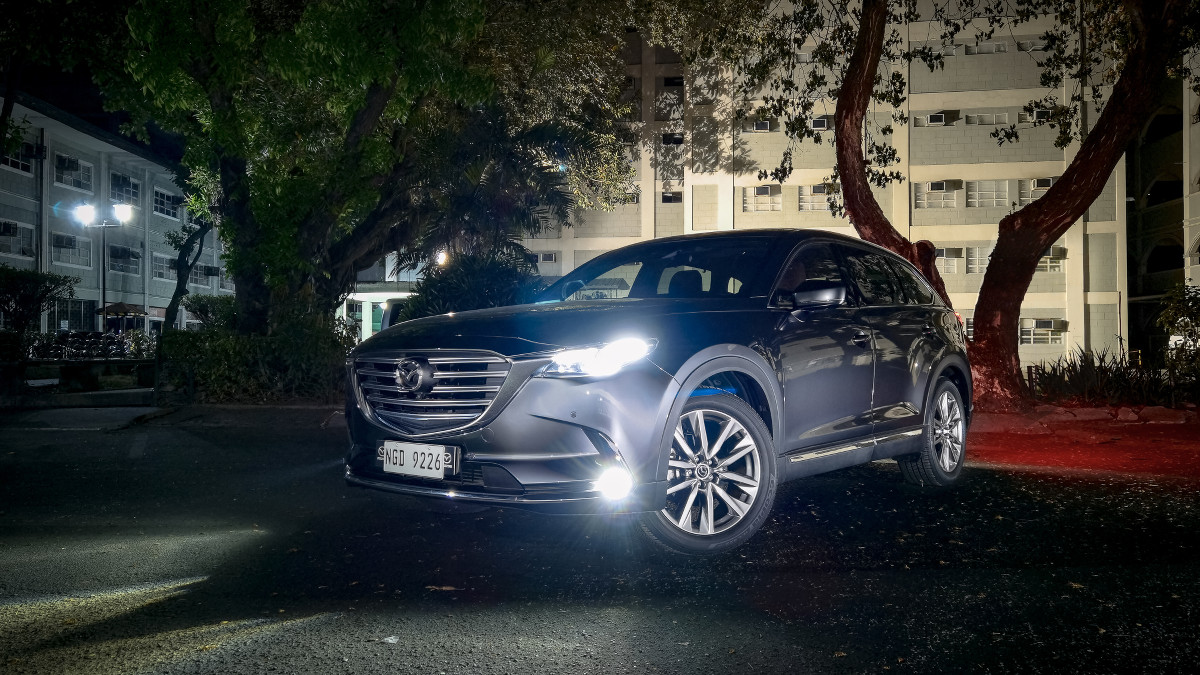 The 2021 Mazda CX-9 AWD Signature - Angled Front View with Head Lights On
