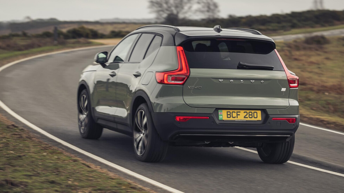 The Volvo XC40 P8 Recharge being driven, rear angle