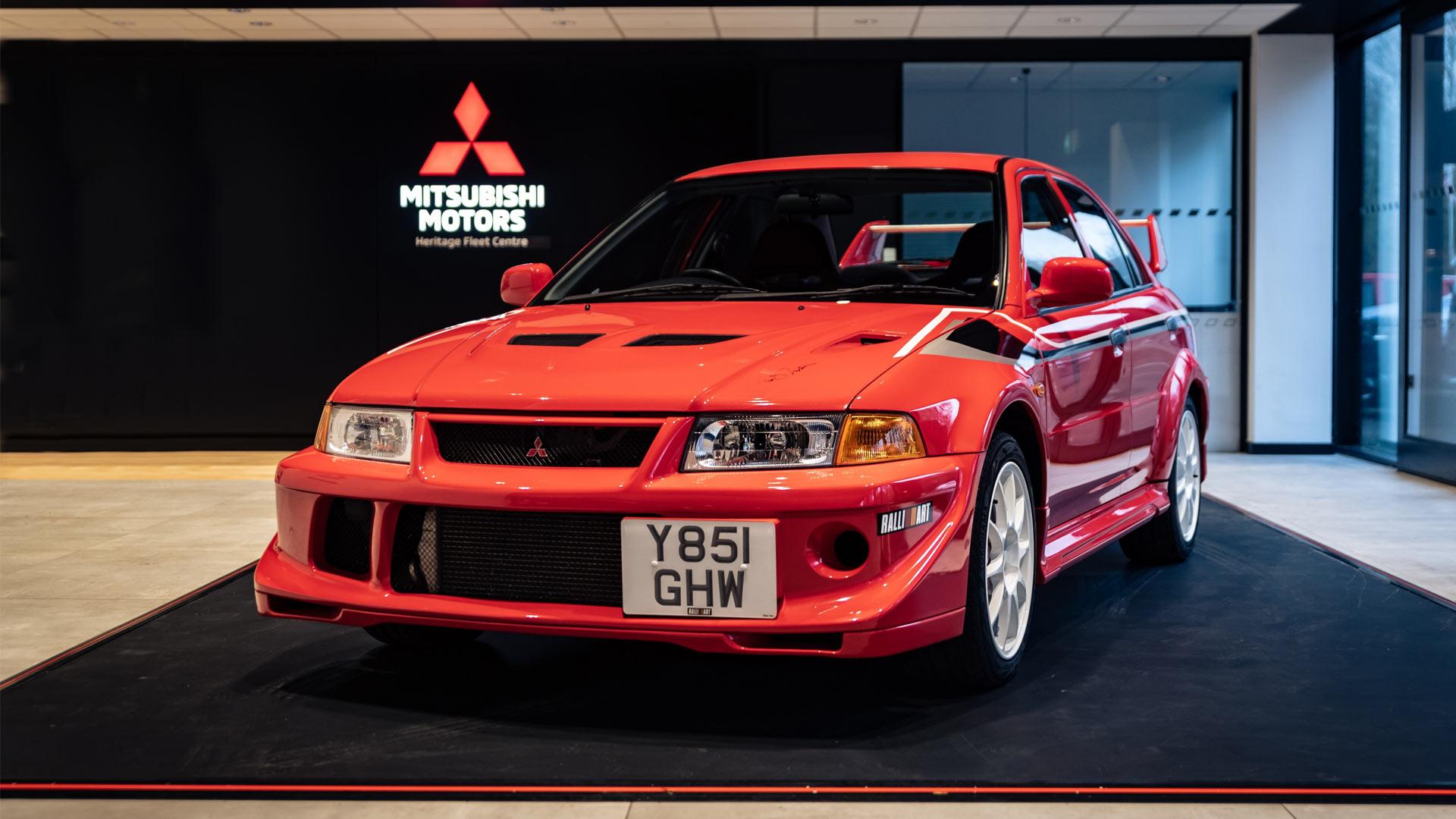 A red Mitsubishi Lancer Evo on display