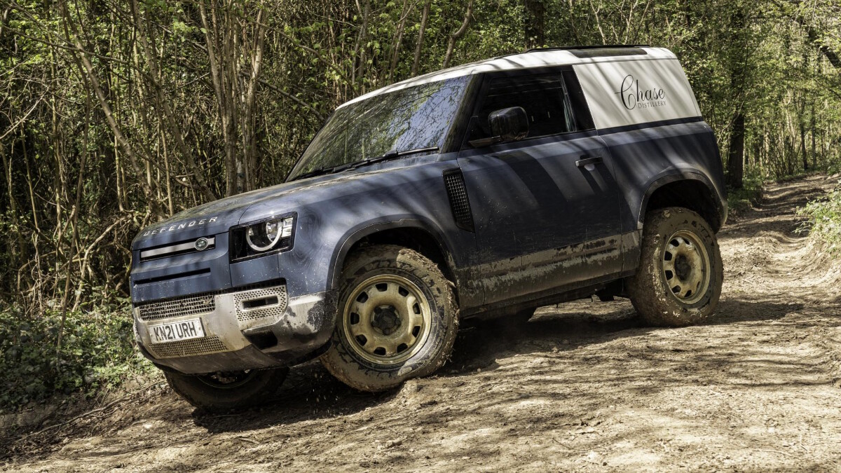 The Land Rover Defender Hard Top with muddied wheels and underchassis