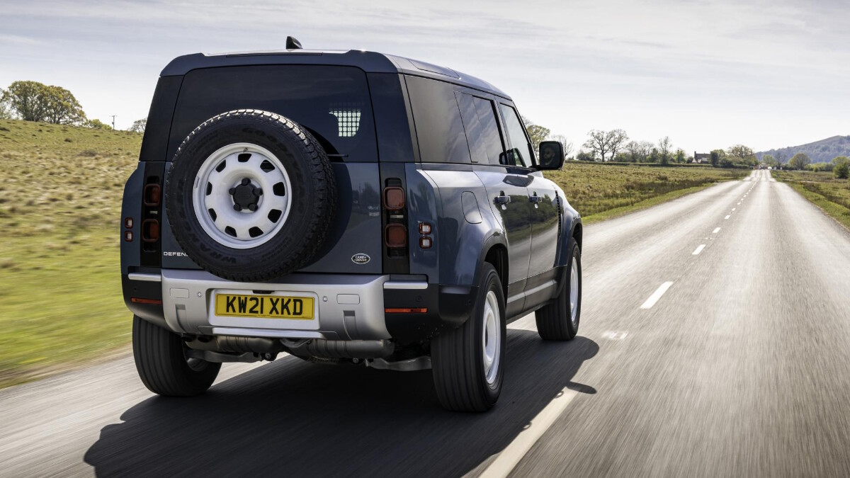 Land Rover Defender Hard Top with an all blue color on the road