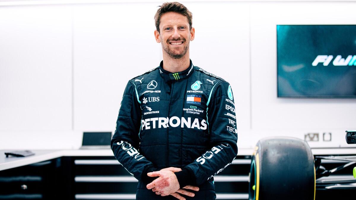 Romain Grosjean at an F1 garage