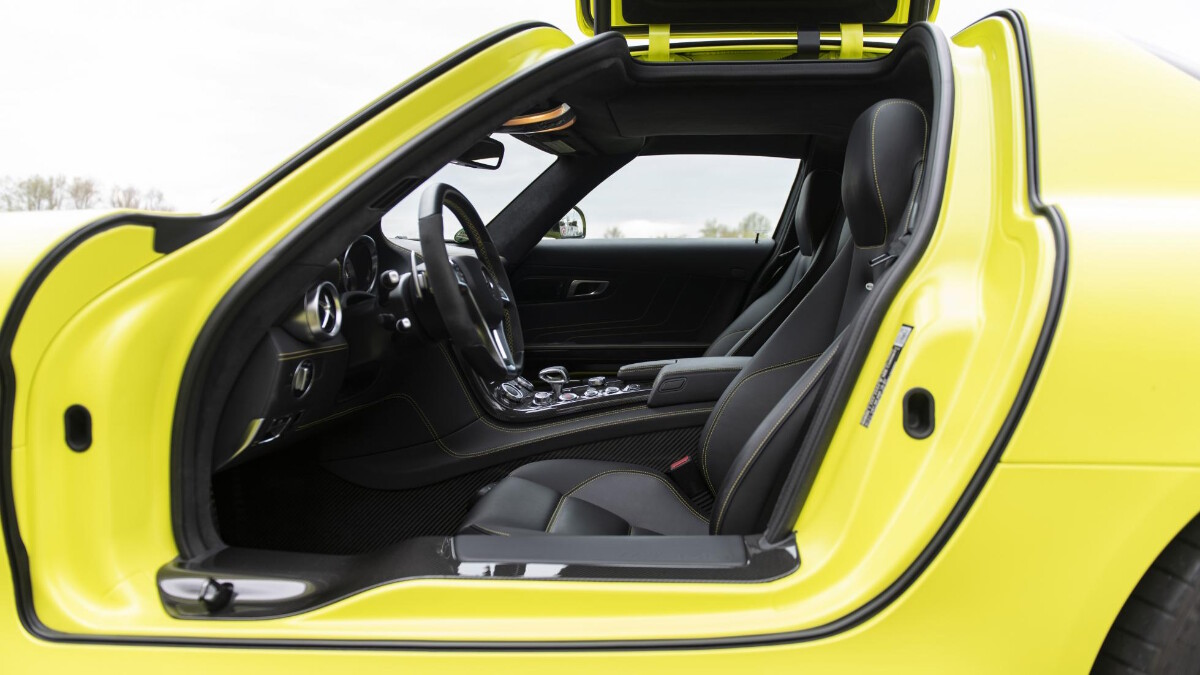 The Mercedes-Benz SLS AMG Electric Drive with its driver-side gull-wing door open.