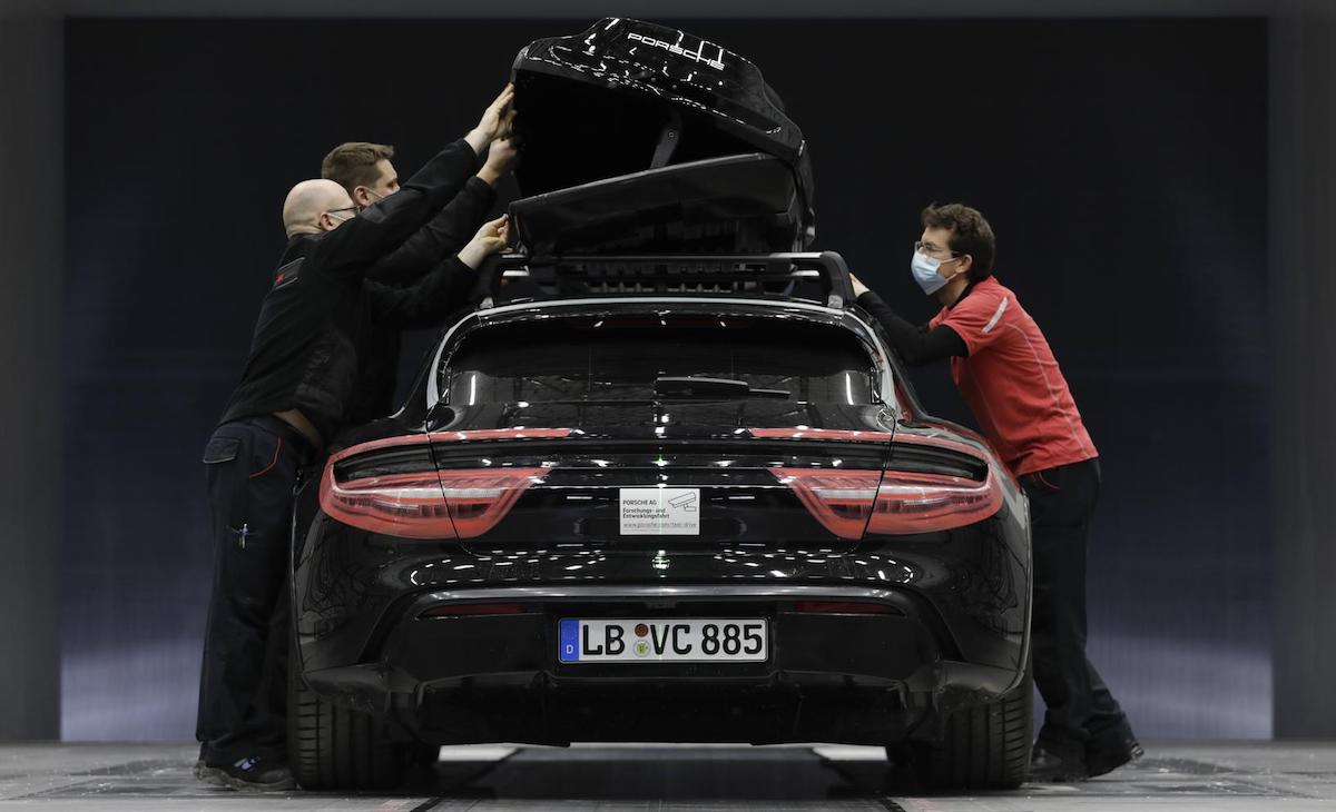 The Porsche Tequipment performance roof box being install on a Cross Turismo
