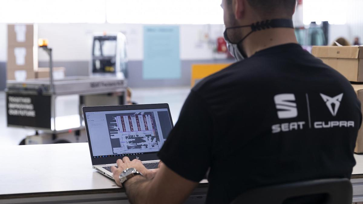 A member of SEAT's team working on a laptop