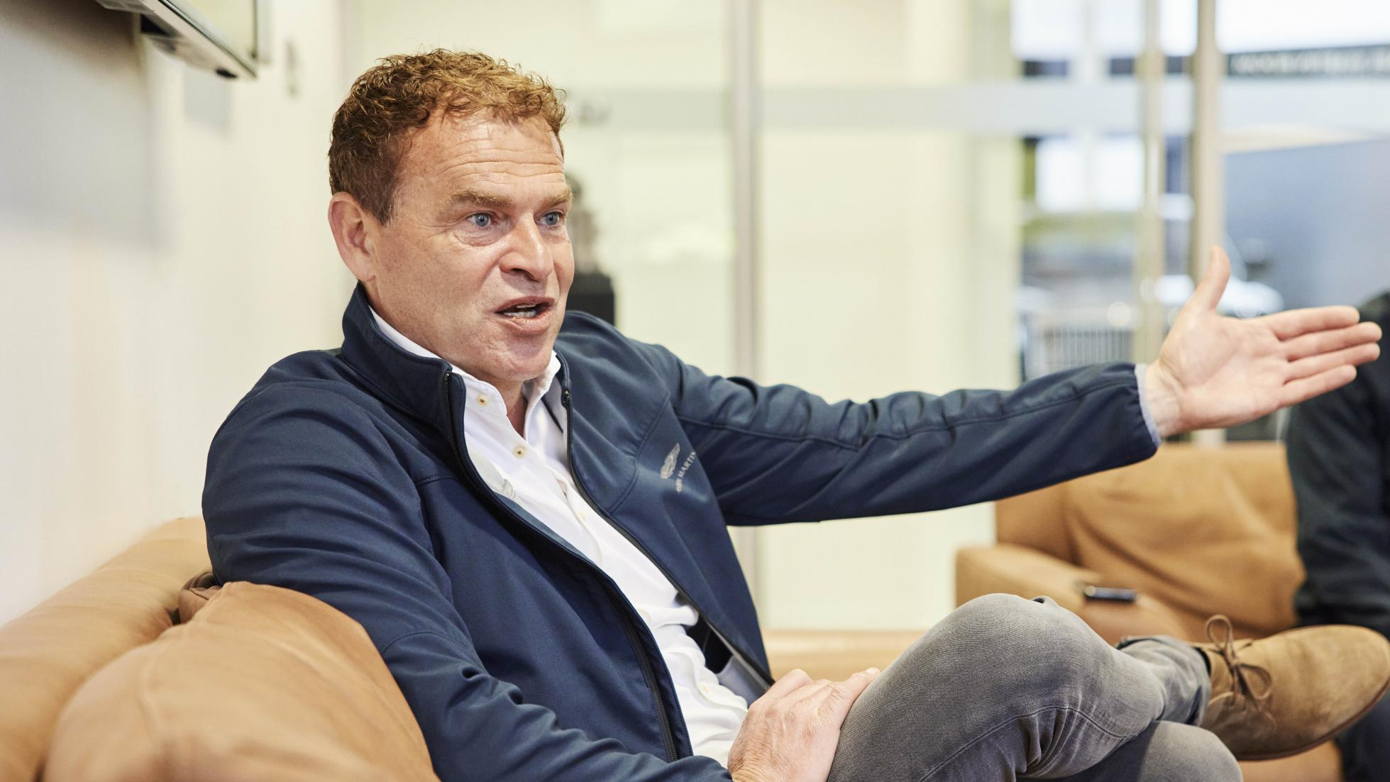 Tobias Moers wearing a blue Aston Martin jacket in an interview