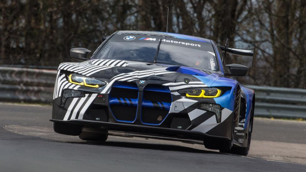 A BMW M4 GT3 with its front two wheels hovering above the track