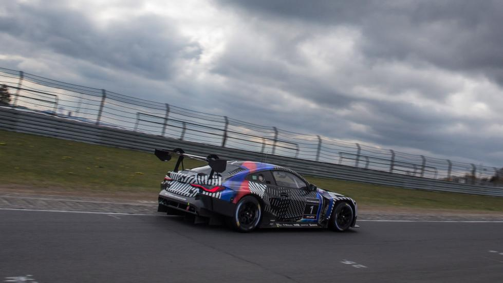 An angled profile view of the BMW M4 GT3 on the track