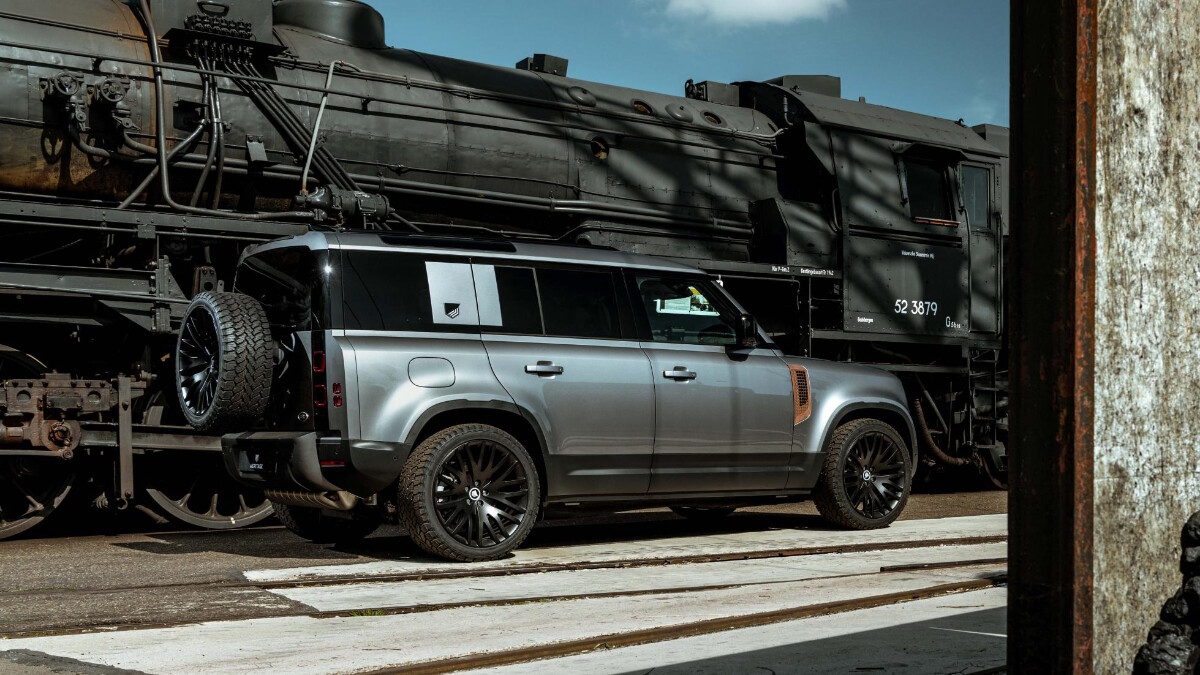 A profile view of a Land Rover Defender with a Heritage Customs rust panel