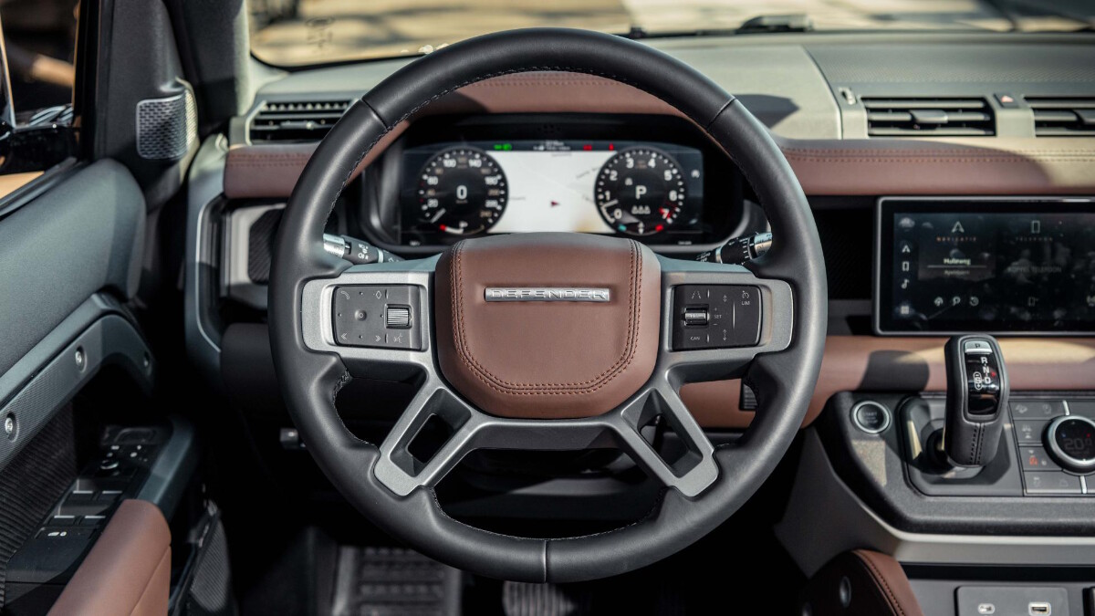 The steering wheel inside a Land Rover Defender