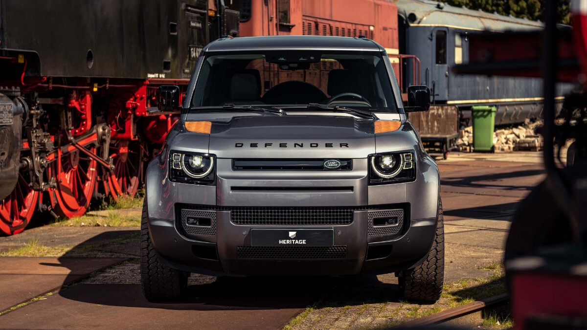 A front view of a Land Rover Defender with Heritage Customs custom rust panels