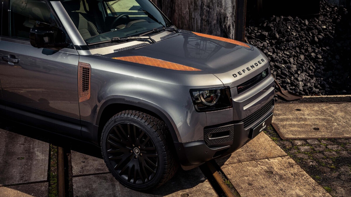 A Land Rover Defender with Heritage Customs custom rust panels