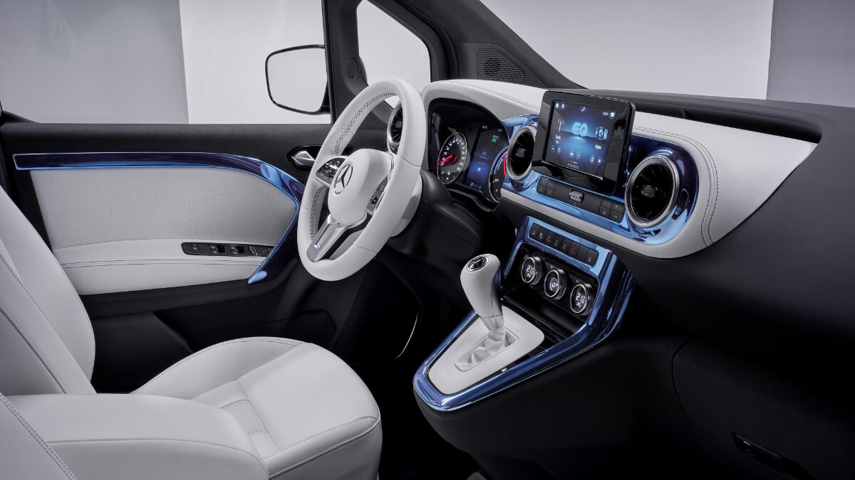 The driver's seat, steering wheel, and center console of the Mercedes-Benz EQT Concept