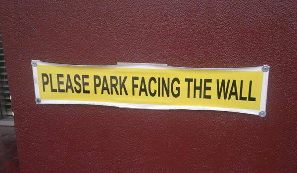 """Face the wall"" parking sign"