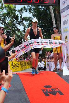 Jenson Button crosses the Cobra Ironman 70.3 finish line