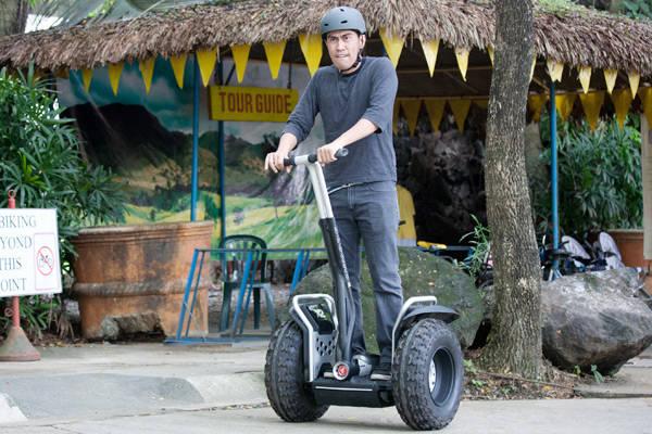 Ramon Bautista rides the Segway PT