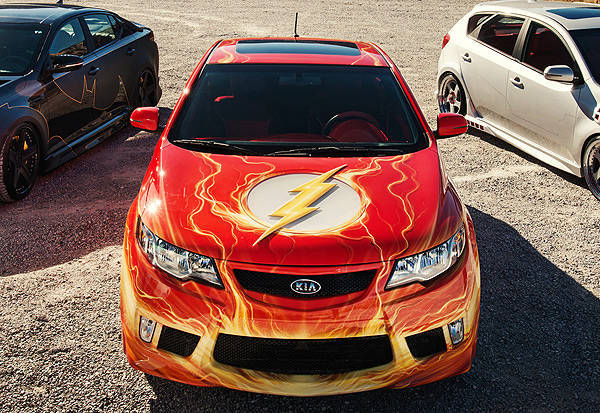 The Flash Themed Kia Forte Koup Has A Red Orange And Yellow Airbrushed Exterior Paint That Matches Scarlet Sdster S Costume While Cutout In