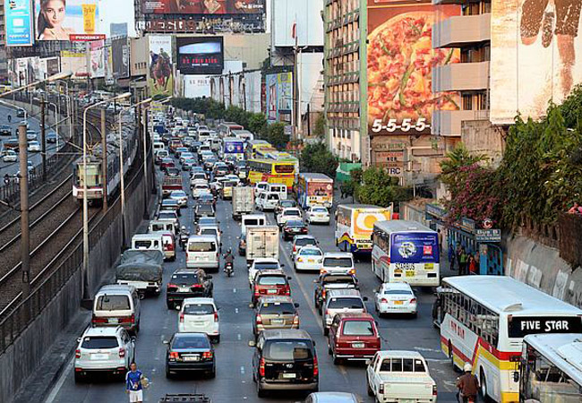 "The Straits Times: ""Painful slog through Manila traffic"""