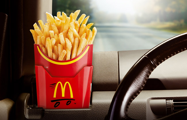This awesome car accessory lets you nibble French fries while driving