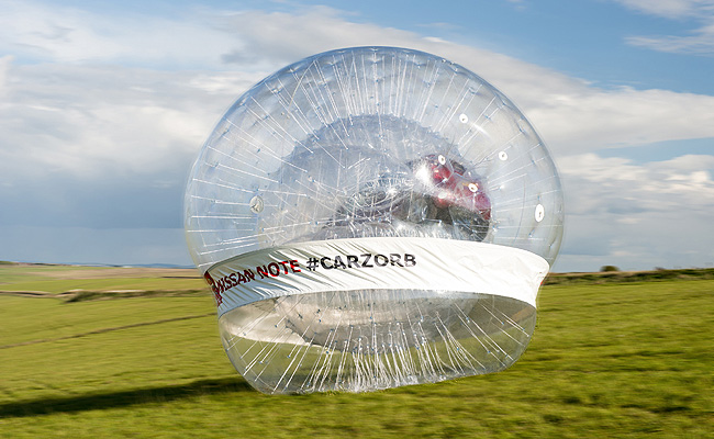 TopGear.com.ph Philippine Car News - Nissan rolls Note MPV downhill in world's largest Zorb